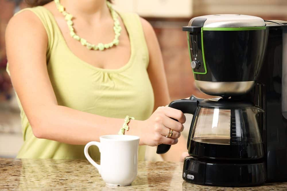 Woman preparing coffee