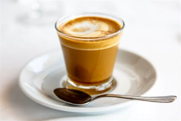 cortado coffee in glass cup